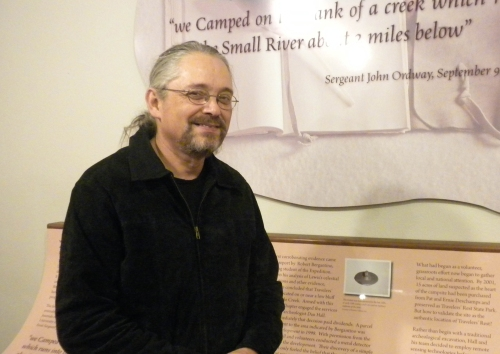 Vernon Carroll in Traveler's Rest Museum, standing next to a quote from the Lewis and Clark journals. Photo courtesy Debbie Lee